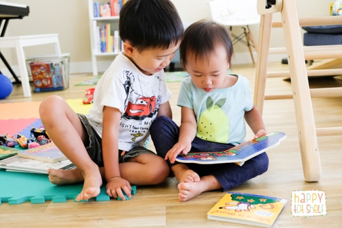 Toddlers reading at home